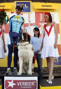 Contador shares the podium with a Saint Bernard dog after winning the 15th stage of the 96th Tour de France cycling race between Pontarlier and Verbier